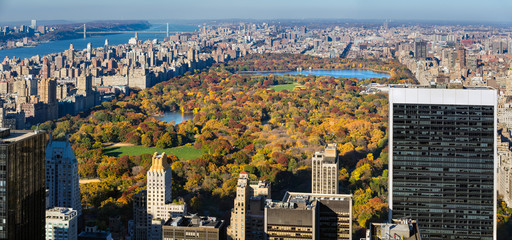 Elevated view of Central Park in autumn colors with skyscrapers and buildings of the Upper West Side, Upper East Side and the distant George Washington Bridge  Manhattan, New York City
