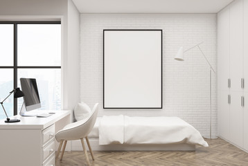 White brick bedroom, computer and poster