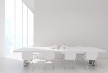 White table in a white kitchen