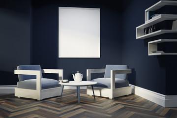 Dark blue living room, armchairs, poster