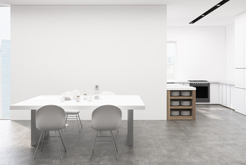 White kitchen with a table