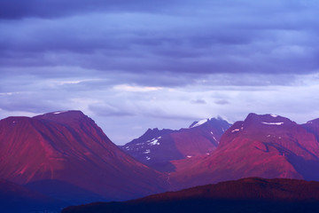Dramatic scene with snowy mountains