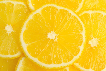 Bright yellow lemon slices, closeup
