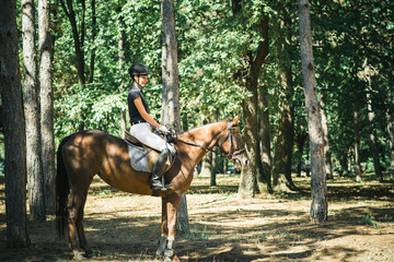 Woman riding horse in nature