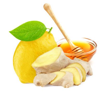 Lemon with honey and ginger root isolated on white background