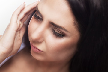 Headache And Stress. Beautiful Young Woman Feeling Strong Head Pain. Portrait Of Tired Stressed Female Suffering From Painful Migraine, Holding Hands Near Face. Health Care Concept.