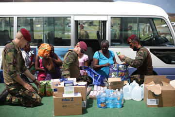 Members of Dutch Armed Forces deliver baby food to residents following Hurricane Irma in Sint Maarten