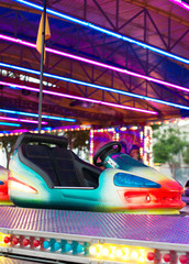 Colorful electric bumper car in amusement park.