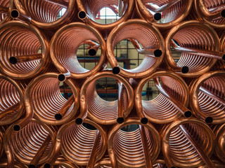 Heat exchangers obtained by wrapping copper tube.