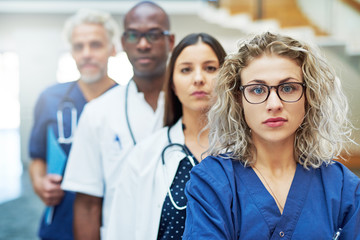 Thoughtful team of doctors looking at camera