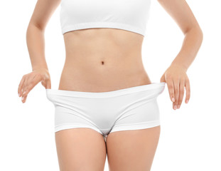 Young woman in underwear on white background. Diet concept