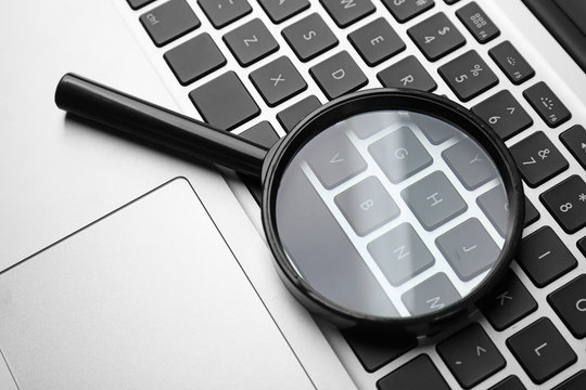 Magnifying glass on laptop. Internet search concept