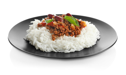 Chili con carne served with rice on plate against white background