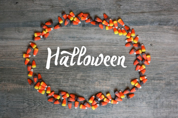 Wall Mural - Halloween Calligraphy With Candy Corn Oval Border Over Rustic Wooden Background, Horizontal, Copy Space