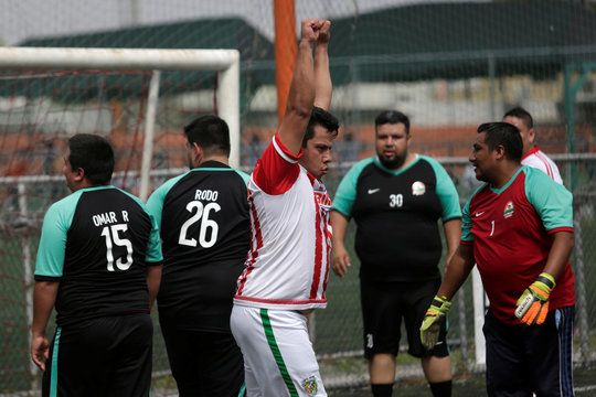 """A man celebrates a goal during his """"Futbol de Peso"""" (Soccer of Weight ) league soccer match, a league for obese men who want to improve their health through soccer and nutritional counseling, in San Nicolas de los Garza"""