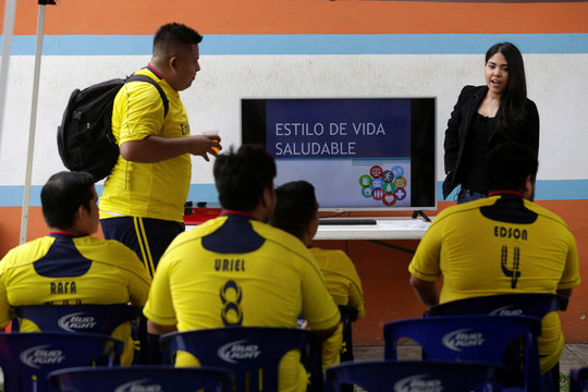 """Players receive nutritional guidance after their """"Futbol de Peso"""" (Soccer of Weight ) league soccer match, a league for obese men who want to improve their health through soccer and nutritional counseling, in San Nicolas de los Garza"""