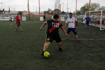 "A player takes the ball during his ""Futbol de Peso"" (Soccer of Weight ) league soccer match, a league for obese men who want to improve their health through soccer and nutritional counseling, in San Nicolas de los Garza"