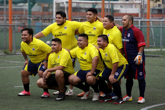 """Players pose for a photo during their """"Futbol de Peso"""" (Soccer of Weight ) league soccer match, a league for obese men who want to improve their health through soccer and nutritional counseling, in San Nicolas de los Garza"""
