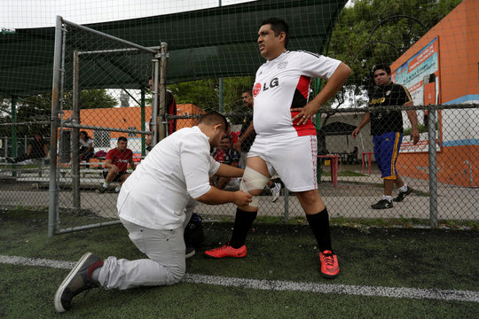 """A man wears a bandage on knee during a """"Futbol de Peso"""" (Soccer of Weight ) league soccer match, a league for obese men who want to improve their health through soccer and nutritional counseling, in San Nicolas de los Garza"""