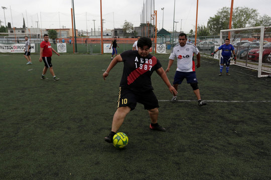 """A player takes the ball during his """"Futbol de Peso"""" (Soccer of Weight ) league soccer match, a league for obese men who want to improve their health through soccer and nutritional counseling, in San Nicolas de los Garza"""