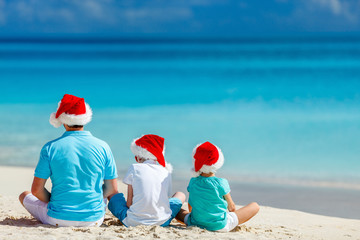 Father with kids at beach on Christmas