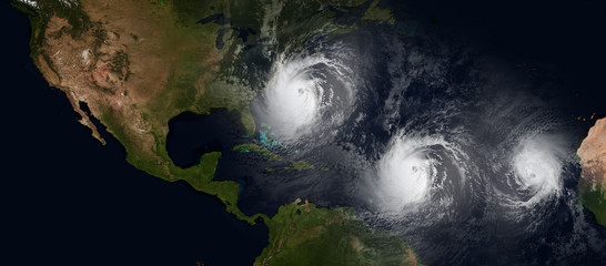 Extremely detailed and realistic high resolution 3d illustration of 3 hurricanes approaching northeast of USA. Shot from Space. Elements of this image are furnished by Nasa.