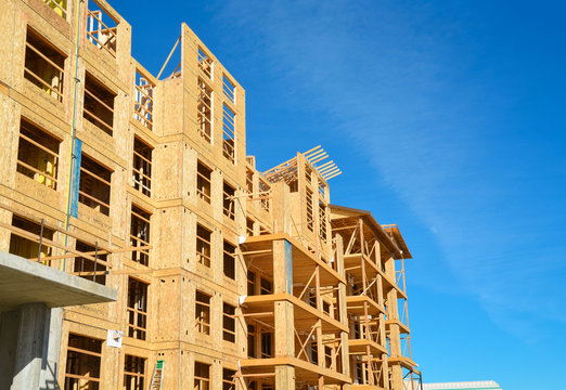 New low-rise building under construction on sunny day in British Columbia, Canada
