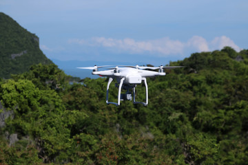 Drones camera in the sky with ocean views background