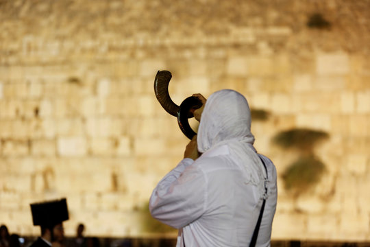 A Jewish worshipper blows a Shofar as he takes part in Slichot at the Western Wall in Jerusalem's Old City