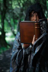 Picture of witch reading spell