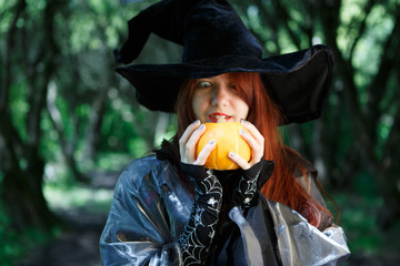 Picture of young witch with pumpkin