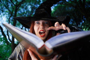 Close-up image of witch reading spell