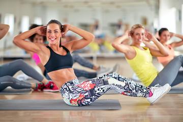 Attractive women train in group