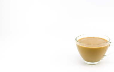 The milk coffee in a transparent glass