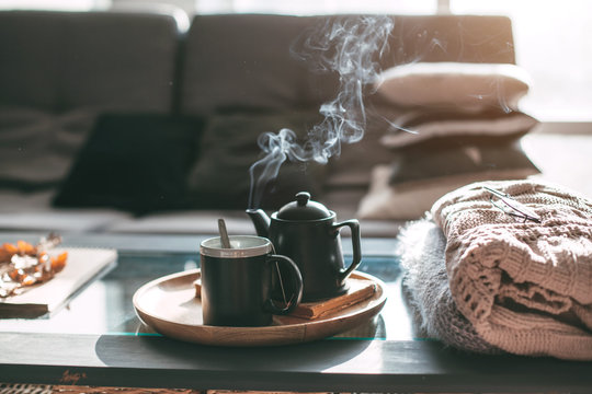 Tea with steam in room in morning sunlight