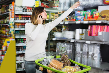 Adult woman talking on phone about shopping