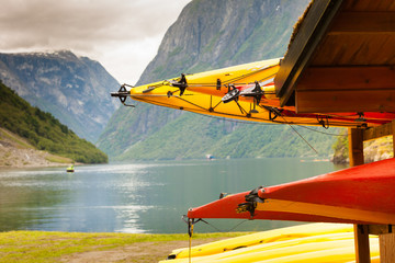 Many canoes on norwegian fjord shore