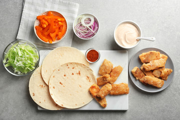 Ingredients for fish tacos on table