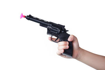 hand of children holding toy gun isolated on white background.