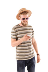 Young hipster man using smartphone on white background