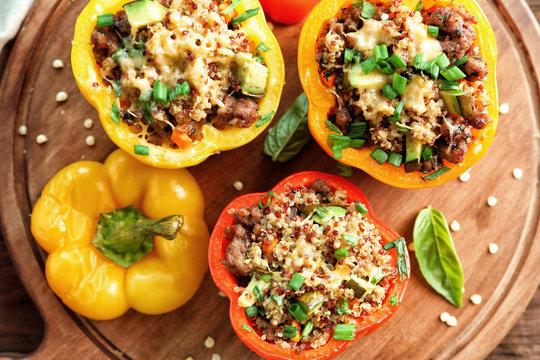 Quinoa stuffed peppers on wooden board