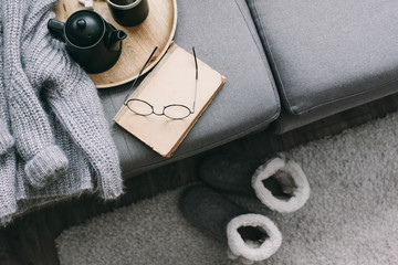 Sweater and reading on sofa