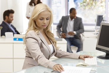 Attractive businesswoman working at desk