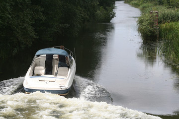 Motor boat and river gate