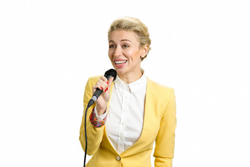 Young business lady speaking to audience. Smiling business woman holding microphone isolated on white background.