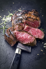Barbecue dry aged wagyu rib eye steak as close-up on slate