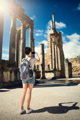 The girl is photographing the phone ruins. Journey. Tunisia, Dougga.