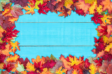 Blank rustic antique teal blue wood sign with colorful autumn leaves border