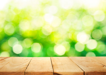 Empty of wood table top on blur of fresh green abstract background .For montage product display  key visual layout
