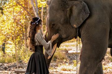 Portrait art of beautiful women and elephants in nature